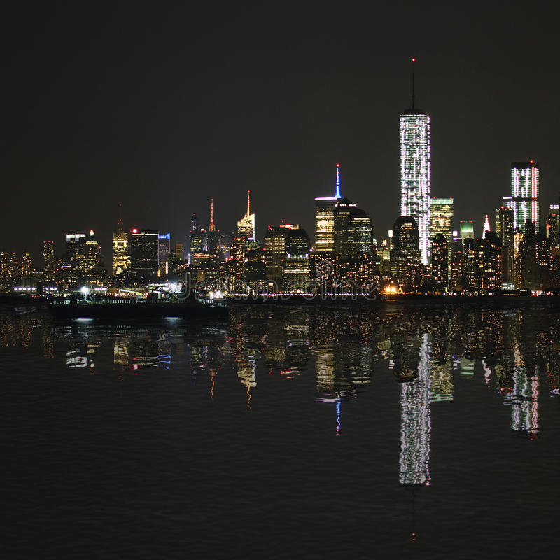 Manhattan at night, New York City skyline with reflection stock images