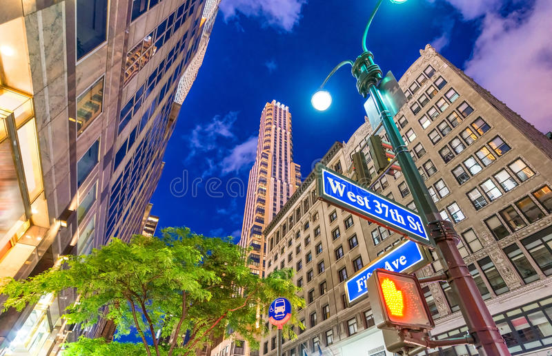 Manhattan at night. Street signs with tall skyscrapers on backhround.  stock image