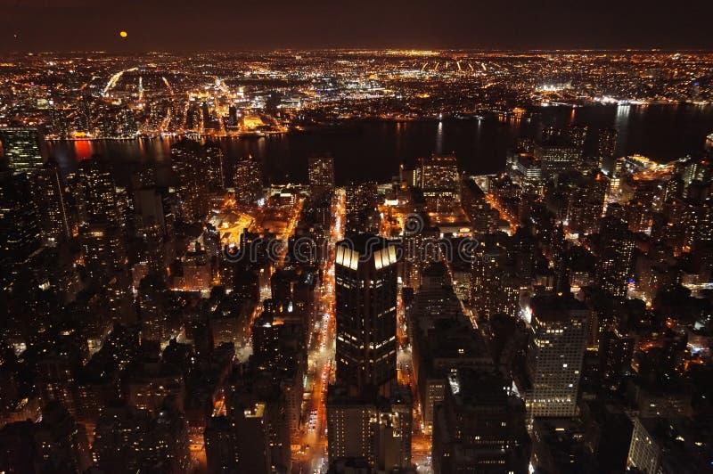 Manhattan at night royalty free stock photos