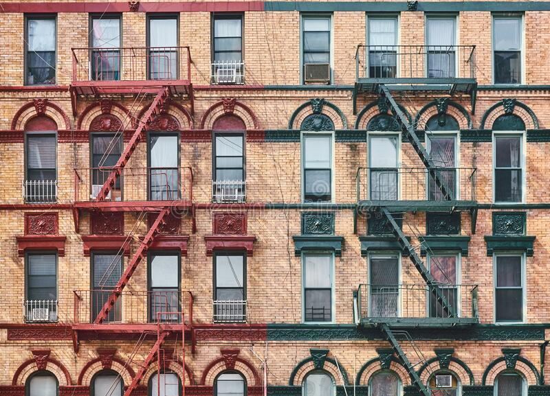 Manhattan old residential building with fire escapes, New York royalty free stock image