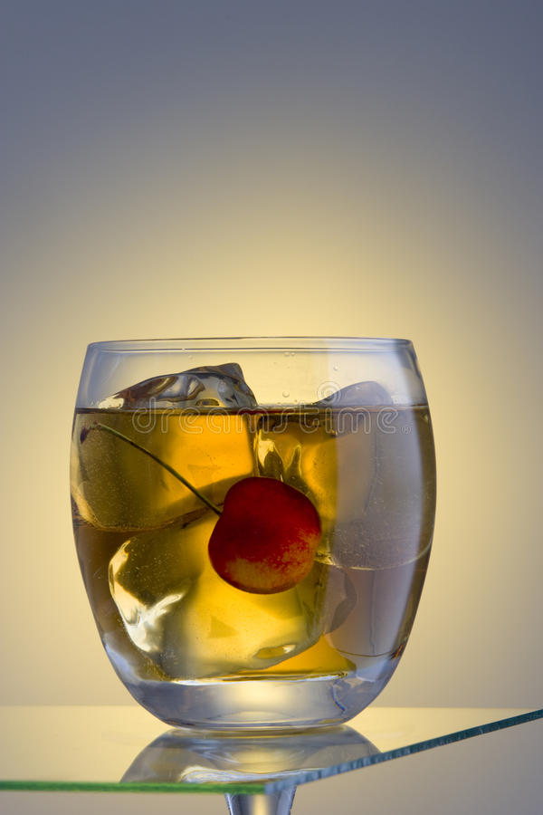 Manhattan or Rob Roy cocktail on the rocks. Manhattan or Rob Roy mixed drink on ice stock photo