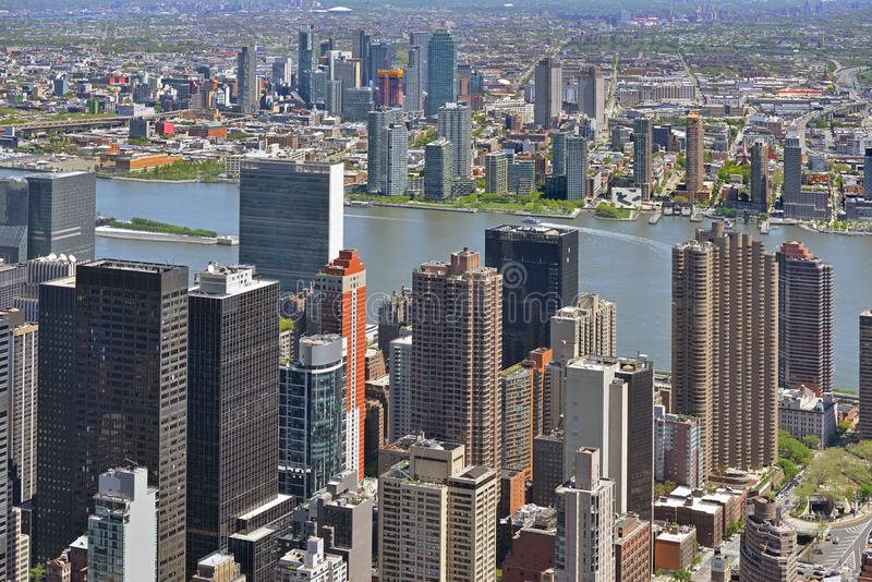 Manhattan`s famous skyscrapers and Long Island, densely populated island off East Coast of United States.  stock photo