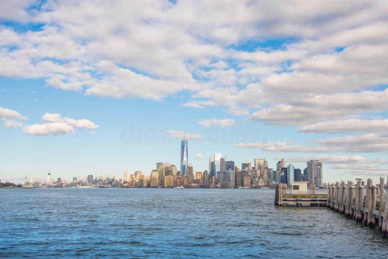Manhattan scene from Statue of Liberty island ,New York city royalty free stock photo