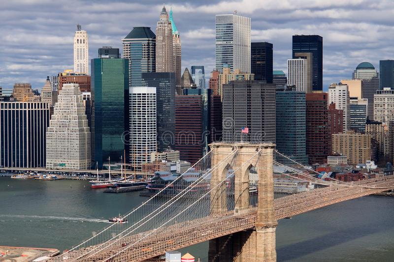 Manhattan skyline. Scenic view of lower Manhattan skyline viewed over East river and Brooklyn bridge, New York city, U.S.A stock images