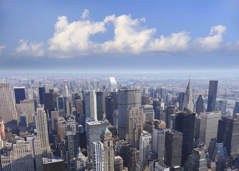 Manhattan skyline. Manhattan, NYC, New York city skyline with love heart shaped clouds stock photos