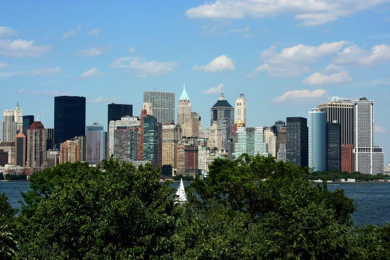 Manhattan skyline. View of the manhattan skyline from ellis island royalty free stock photos