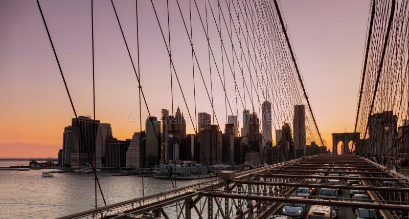 Manhattan skyline with Brooklyn Bridge evening sunset viewed in summer. Manhattan skyline with Brooklyn Bridge evening at sunset viewed in summer stock photo