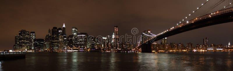 Manhattan Skyline and Brooklyn Bridge at Night royalty free stock images