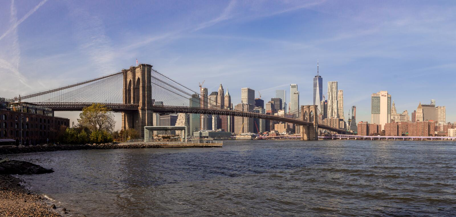 Manhattan skyline from Brooklyn and Brooklyn bridge. A panorama high resolution view of the lower manhattan skyline with the Brooklyn Bridge taken from Dumbo royalty free stock images