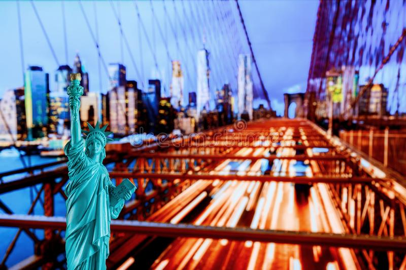 Manhattan Skyline, Brooklyn Bridge and The Statue of Liberty at Night Lights, New York City stock photography