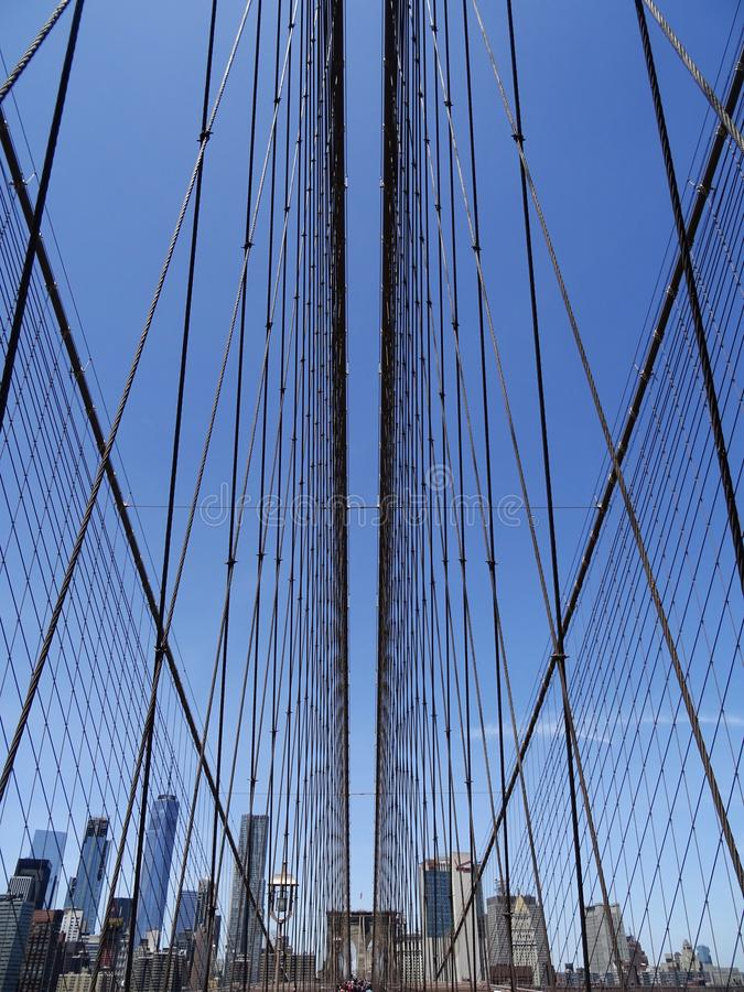 Manhattan Bridge cables and skyline #2 royalty free stock photography