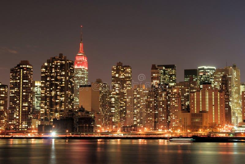 Download Manhattan skyline at Night stock image. Image of america - 1720835