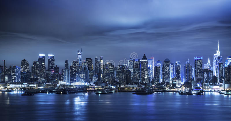 Manhattan Skyline At Night. View of the Manhattan skyline and river in New York City stock photos