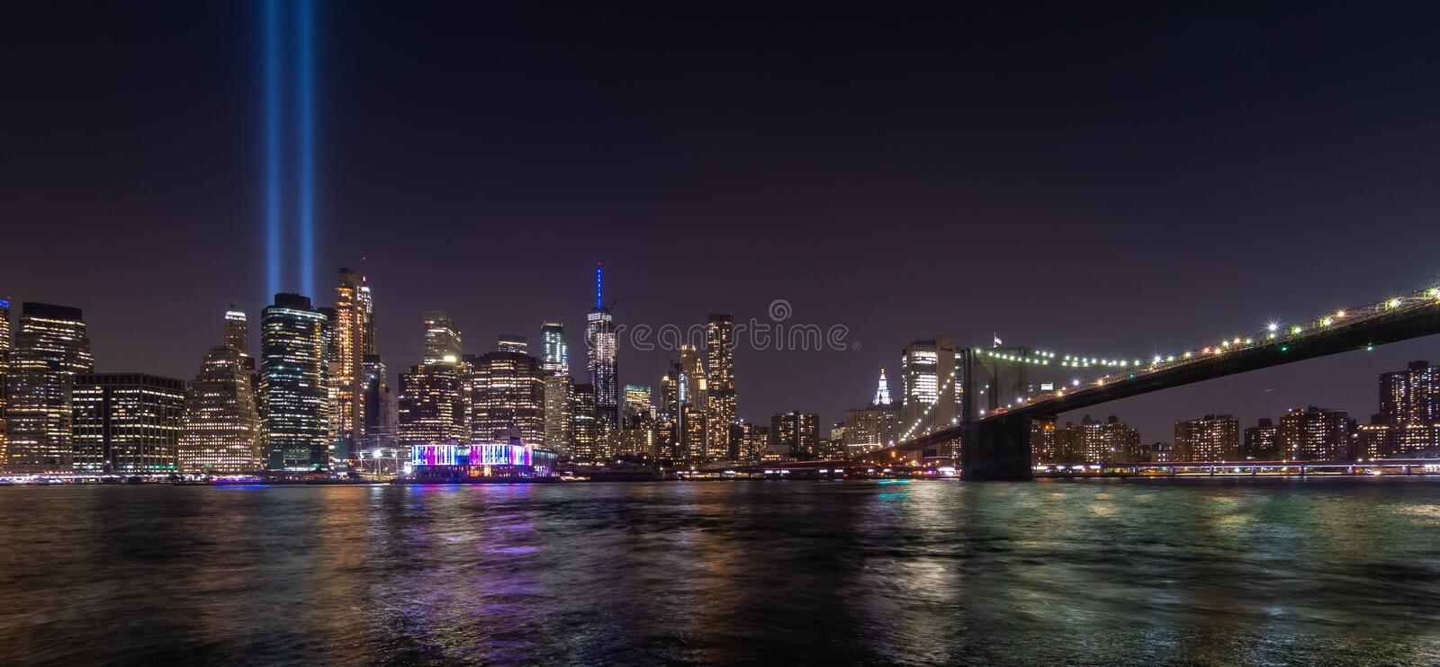 Manhattan skyline at night seen from Brooklyn. Tribute in Light royalty free stock photos