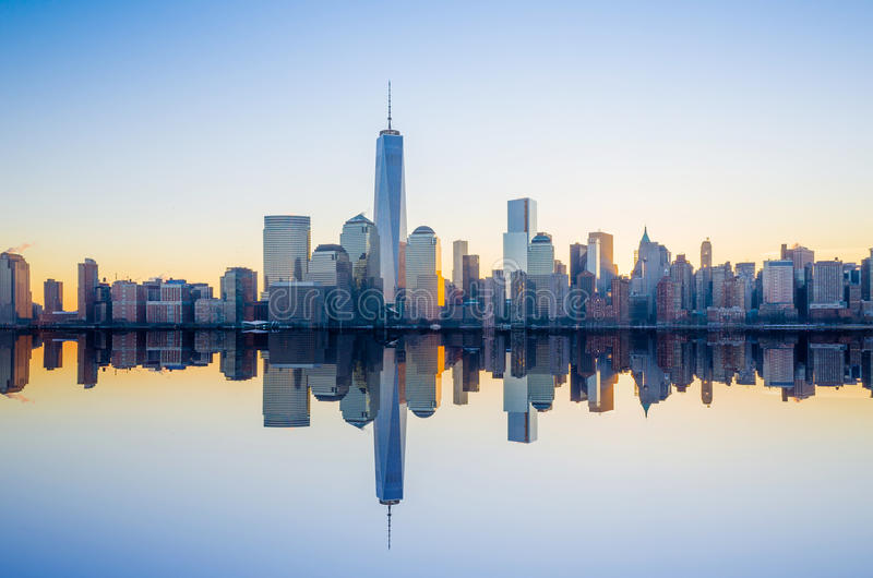 Manhattan Skyline with the One World Trade Center building at twilight. New York City stock photo