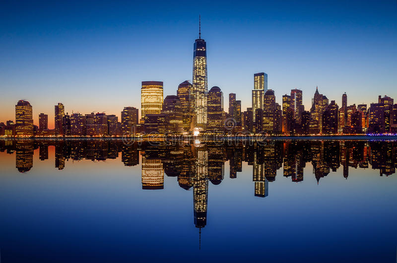 Manhattan Skyline with the One World Trade Center building at twilight. New York City stock photography