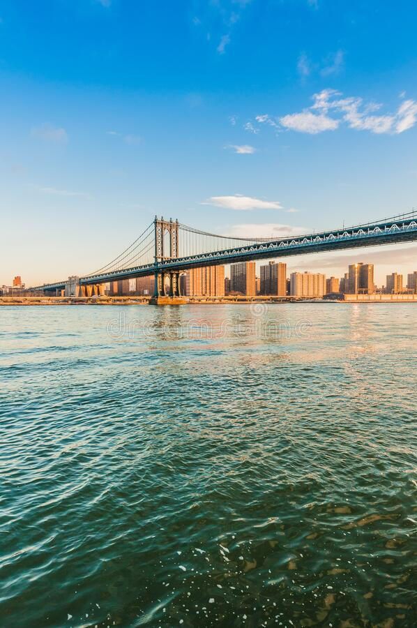 Manhattan Skyline from Pebble Beach in Brooklyn, United States. Manhattan Skyline sunrise as seen from Pebble Beach in Brooklyn, New York, United States of stock photos