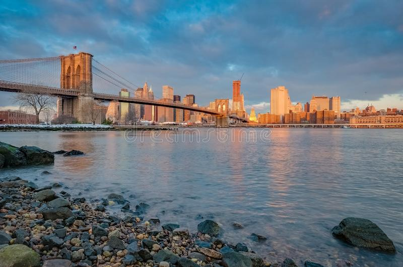 Manhattan Skyline from Pebble Beach in Brooklyn, United States. Manhattan Skyline sunrise as seen from Pebble Beach in Brooklyn, New York, United States of royalty free stock images