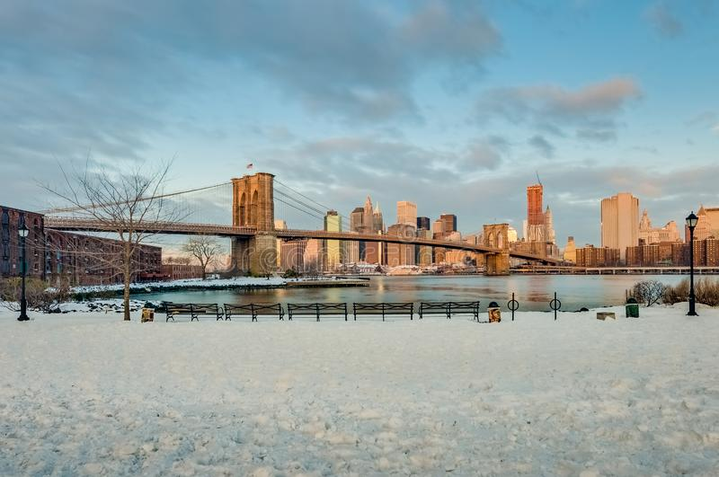 Manhattan Skyline from Pebble Beach in Brooklyn, United States. Manhattan Skyline sunrise as seen from Pebble Beach in Brooklyn, New York, United States of royalty free stock photos
