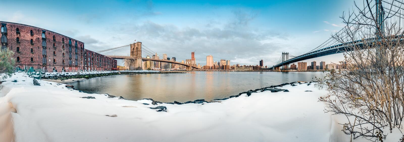 Manhattan Skyline from Pebble Beach in Brooklyn, United States. Manhattan Skyline sunrise as seen from Pebble Beach in Brooklyn, New York, United States of stock photography