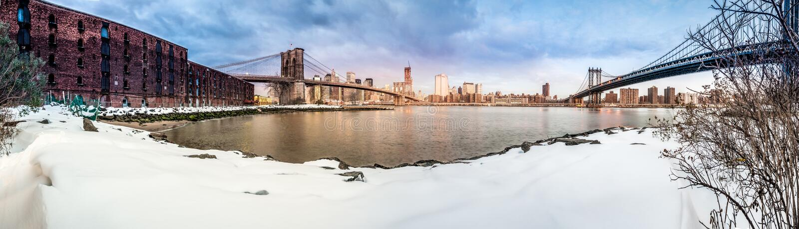 Manhattan Skyline from Pebble Beach in Brooklyn, United States. Manhattan Skyline sunrise as seen from Pebble Beach in Brooklyn, New York, United States of royalty free stock photo