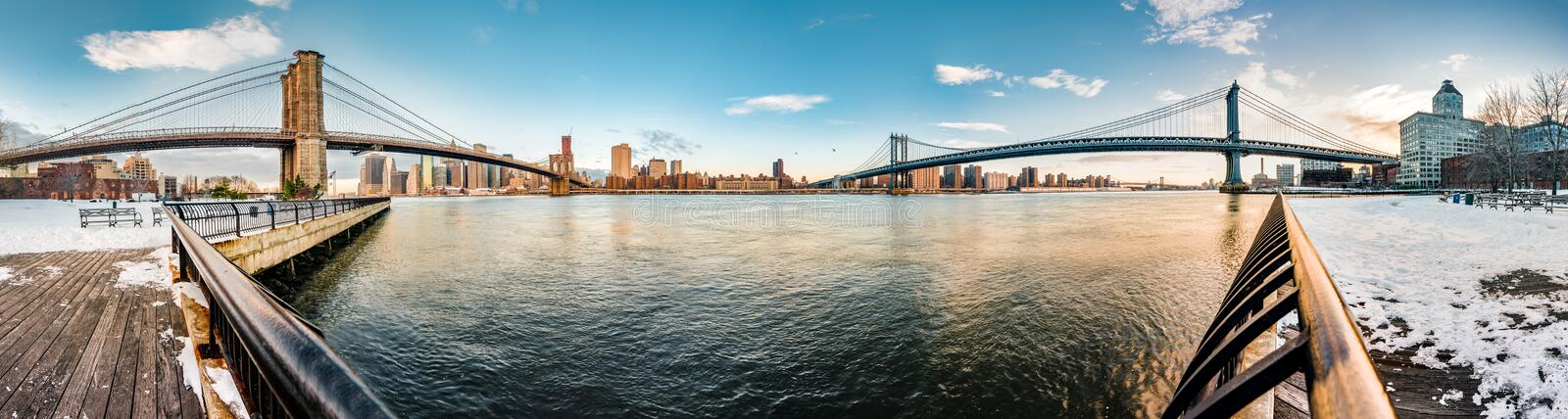 Manhattan Skyline from Pebble Beach in Brooklyn, United States. Manhattan Skyline sunrise as seen from Pebble Beach in Brooklyn, New York, United States of royalty free stock photography