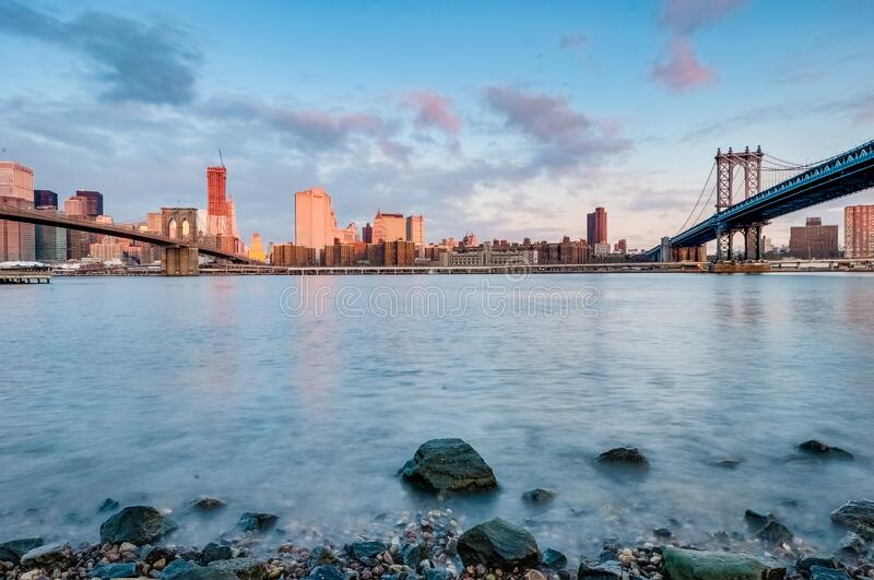 Manhattan Skyline from Pebble Beach in Brooklyn, United States. Manhattan Skyline sunrise as seen from Pebble Beach in Brooklyn, New York, United States of stock image