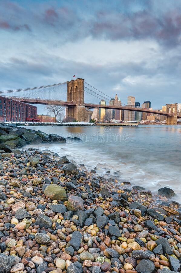 Manhattan Skyline from Pebble Beach in Brooklyn, United States. Manhattan Skyline sunrise as seen from Pebble Beach in Brooklyn, New York, United States of stock images