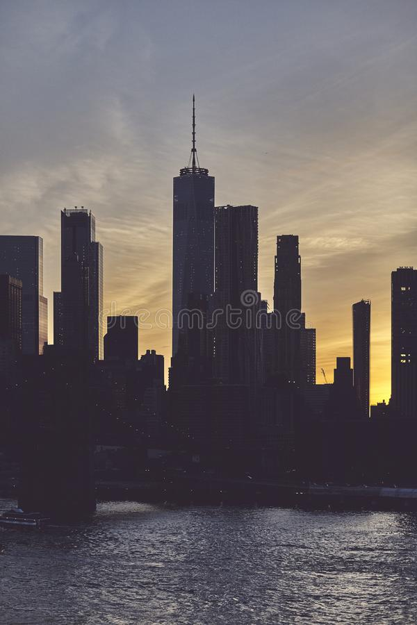 Manhattan skyline silhouette at dusk, NYC royalty free stock image