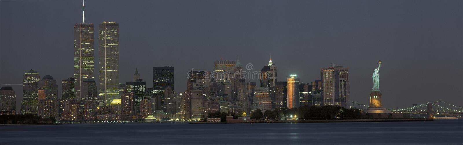 Manhattan skyline with Statue of Liberty stock images
