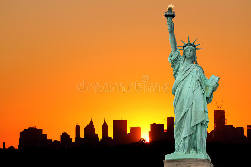Manhattan Skyline and The Statue of Liberty. At Sunset, New York City royalty free stock image