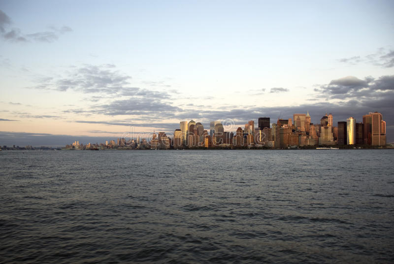 Manhattan skyscrapers at the sunset royalty free stock photo