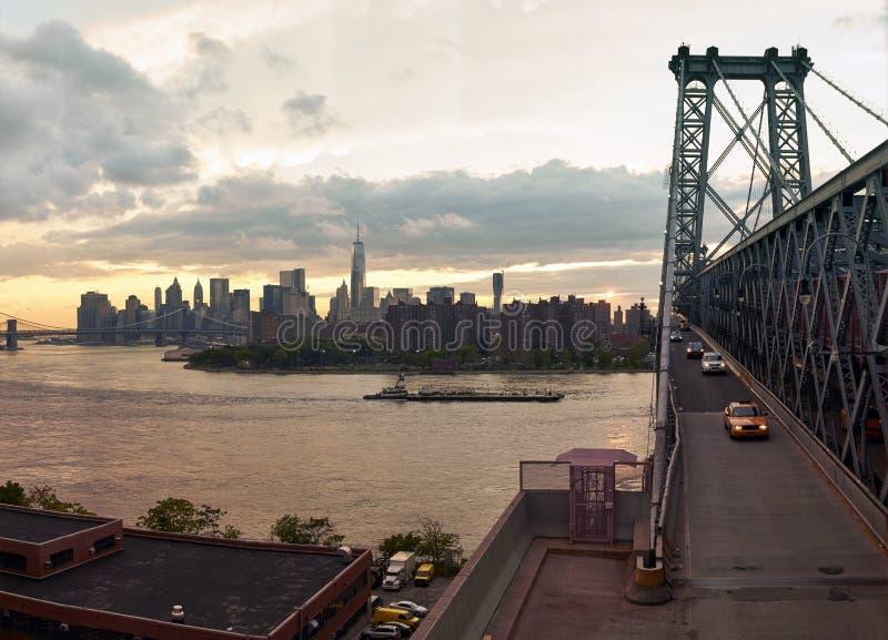 Manhattan sunset from the bridge. Manhattan line sunset from the Wiliamsbourg bridge, NYC stock photos