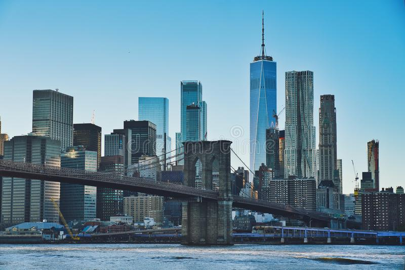Manhattan at Sunset. Photo of the Manhattan at the sunset time with the Brooklyn Bridge stock photos
