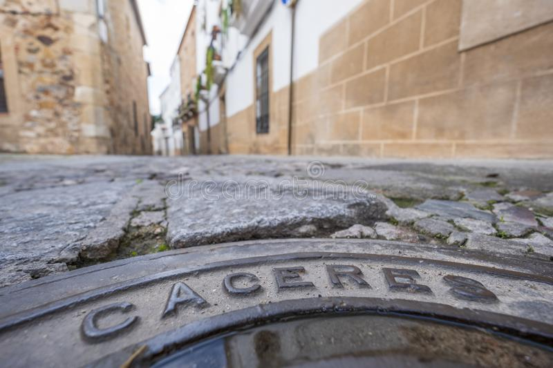 Manhole cover with inscription caceres in the old eponymous historic capital of the province of caceres, extremadura, spain stock photography
