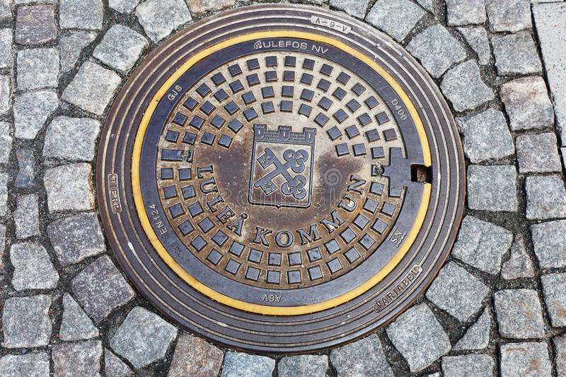 Manhole lid in Lulea royalty free stock photos