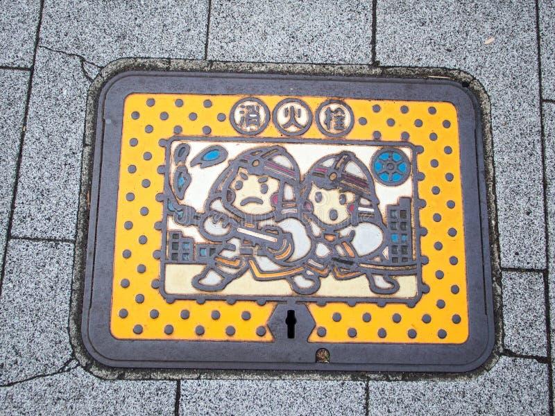 Manhole pokrywa, Minato oddział, Tokio Japonia fotografia stock