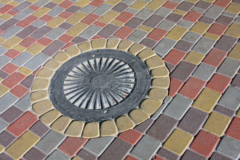 manholetrottoaravklopp royaltyfri bild