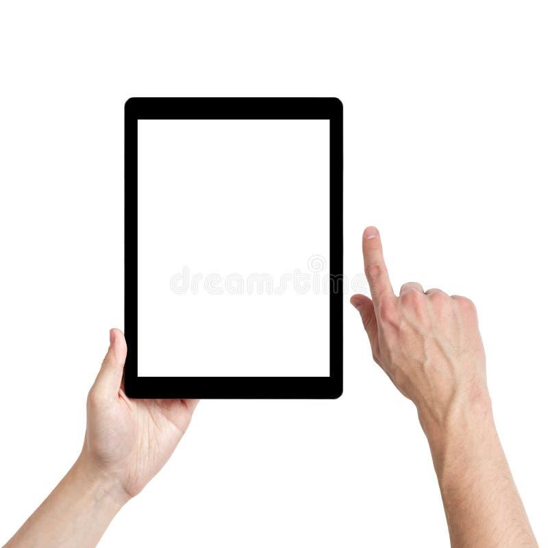 Mani adulte dell'uomo facendo uso del pc della compressa con lo schermo bianco fotografia stock libera da diritti