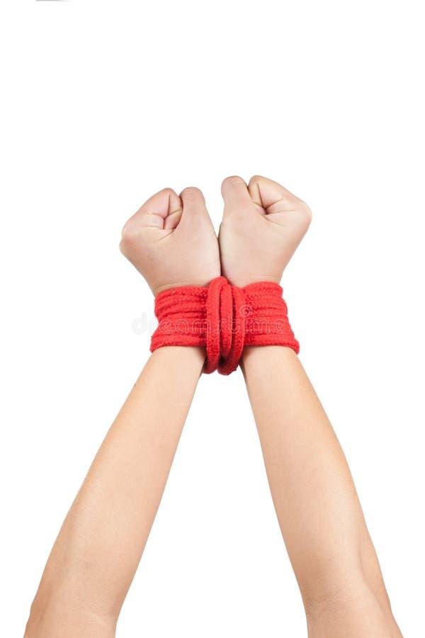 Mani avvolte con la corda immagini stock