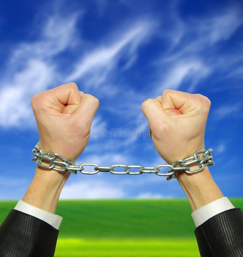 Mani in catena fotografie stock libere da diritti