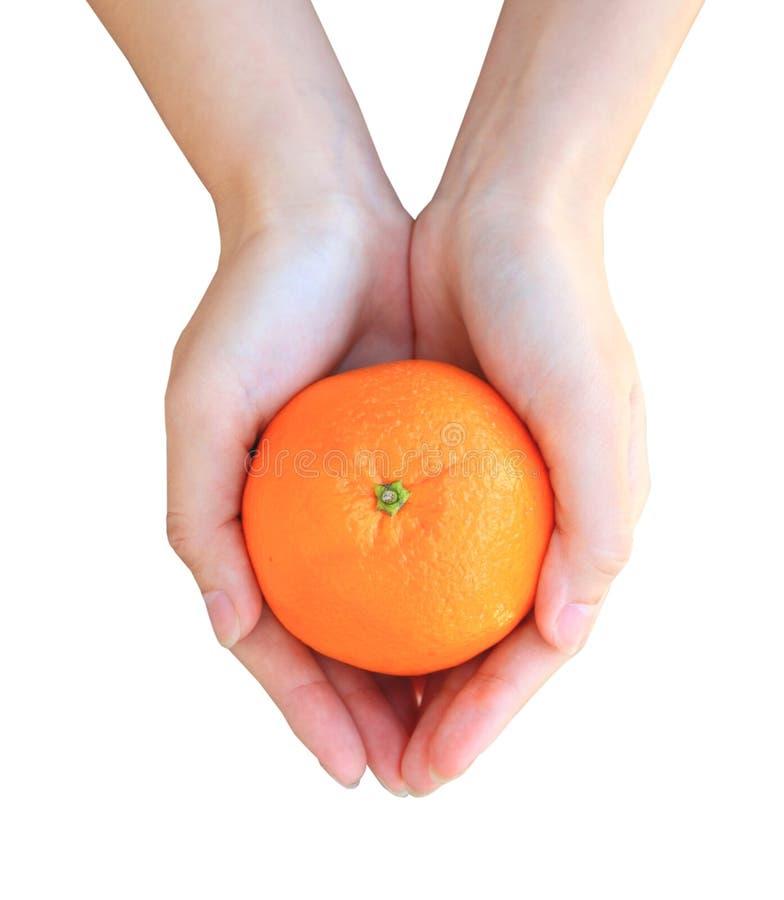 Mani che giudicano arancio isolato su bianco immagine stock