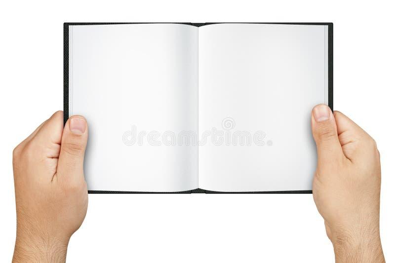 Mani che giudicano libro aperto in bianco isolato fotografia stock libera da diritti