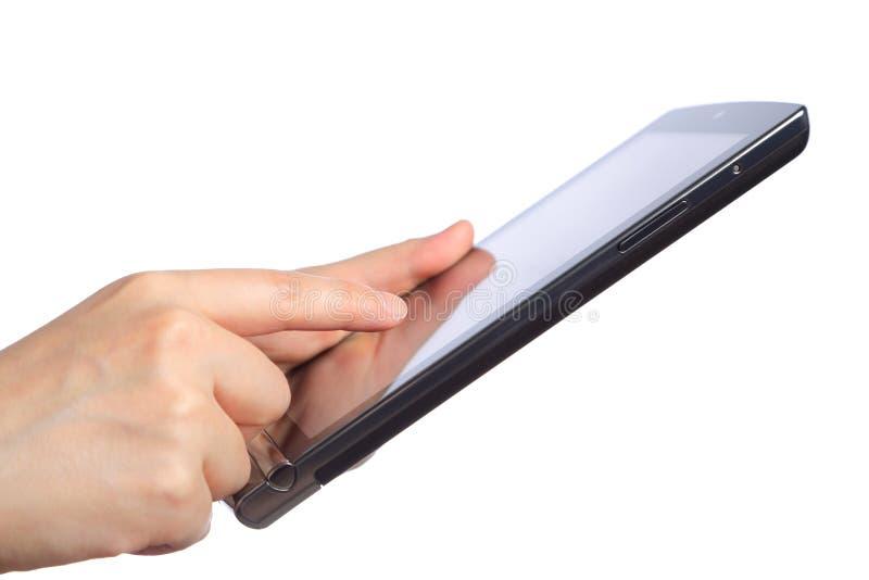 Mani che indicano il pc della compressa del touch screen immagine stock