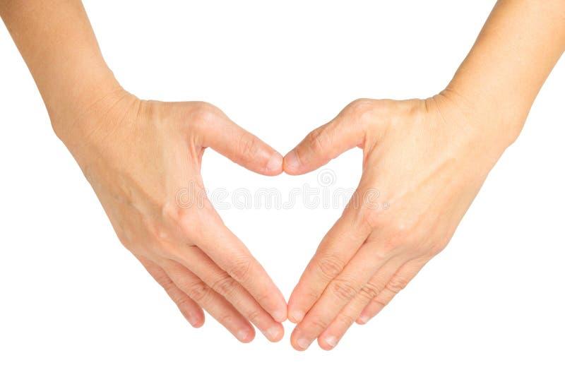 Mani che modellano un simbolo del cuore fotografie stock libere da diritti