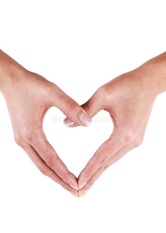 Mani che sviluppano un cuore. immagini stock