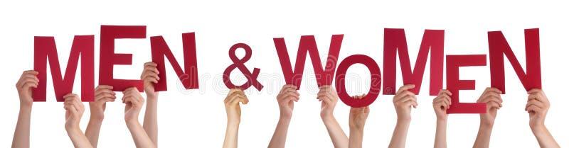 Mani che tengono gli uomini e le donne rossi di parola fotografia stock