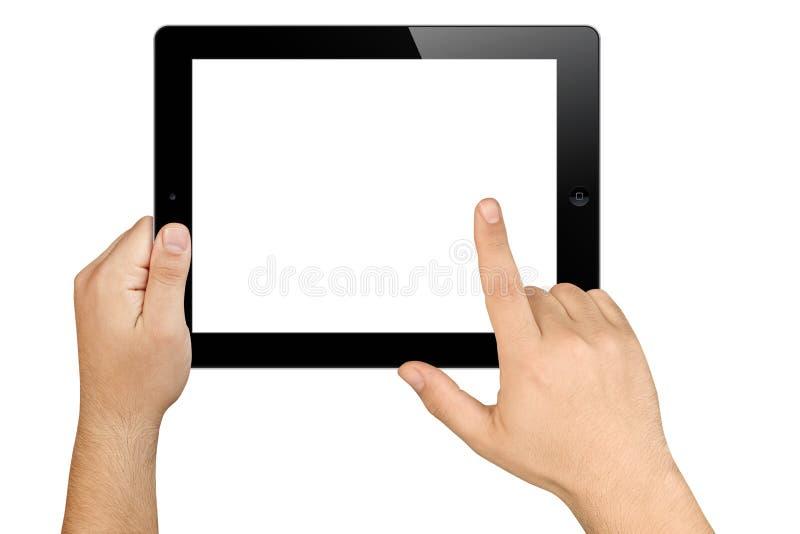 Mani che tengono il pc funzionante della compressa dello schermo in bianco fotografia stock
