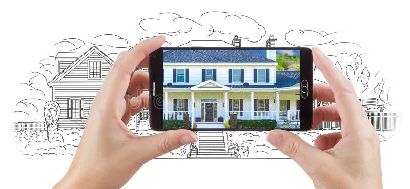 Mani che tengono Smart Phone che visualizza foto domestica di disegno del Behin illustrazione di stock