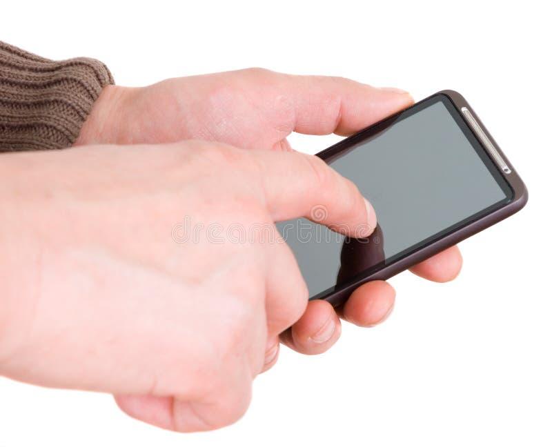 Mani con il trasmettitore immagine stock